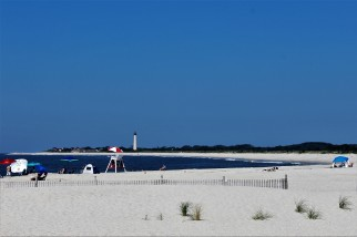 View of the Cape May Lighthouse from the end of the promenade.